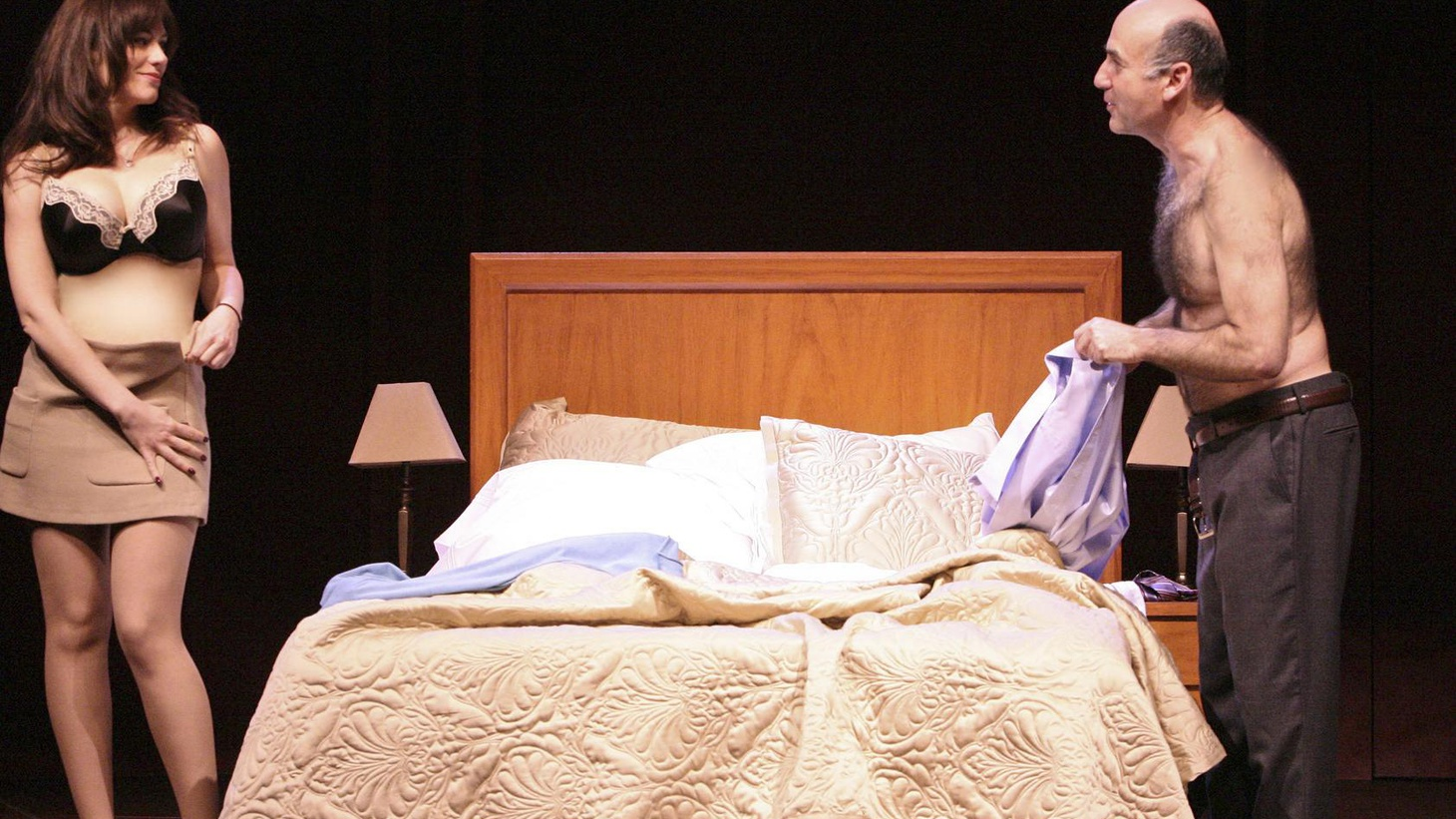 You sit down to see Jane Anderson's new play The Escort. The lights go down, a luscious red curtain opens and there is a beautiful, buxom naked woman center stage...