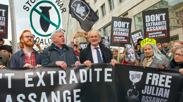John and Gabriel Shipton talk to Robert Scheer about the WikiLeaks founder's grueling struggle to be freed from a London prison as the Biden administration demands his extradition.