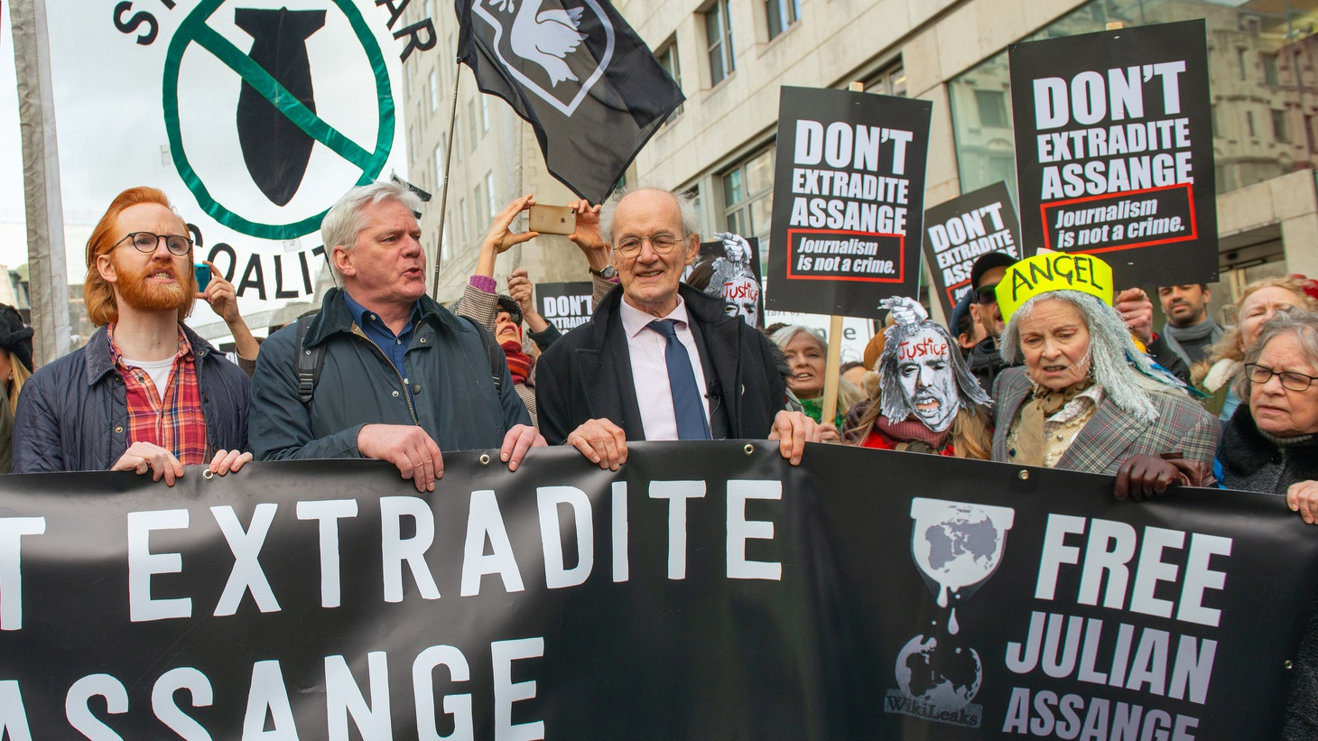 Father John Shipton (center), in protest of WikiLeaks Julian Assange's extradition to the USA.
