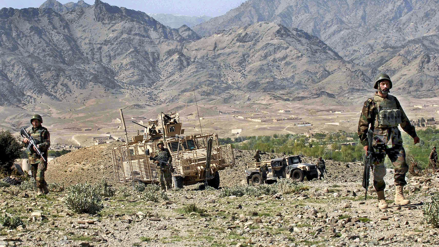 Afghan Army soldiers patrol near the village of Kusheh, Afghanistan, March 24, 2010. The Afghan soldiers have been partnering with U.S. Army Soldiers to help bring stability to part of Khost province. The U.S. Soldiers are assigned to the !st Squadron, 33rd Cavalry Regiment. U.S. Army.
