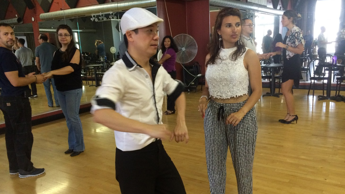 """At Club One Studio Maestro Joo doesn't just teach salsa dance, but tries to create what he calls a """"salsa family."""" Joo tries to instill confidence in each of his students, literally one step at a time.   --Produced by Victor Figueroa"""