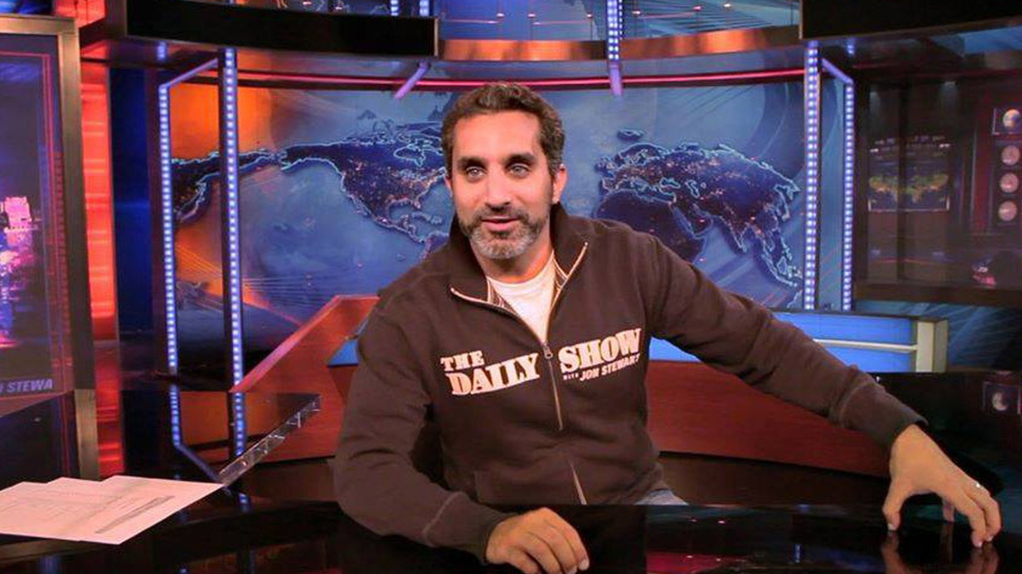 """Known as the """"Jon Stewart of Egypt,"""" Bassem Youssef hosted a satirical news show that was the first of its kind in the Middle East. The show was immensely popular, until the military-backed government forced Youssef off the air and out of the country. Youssef and director Sara Taksler tell us about their documentary Tickling Giants, which profiles Youssef's leap from heart surgeon to super star satirist."""