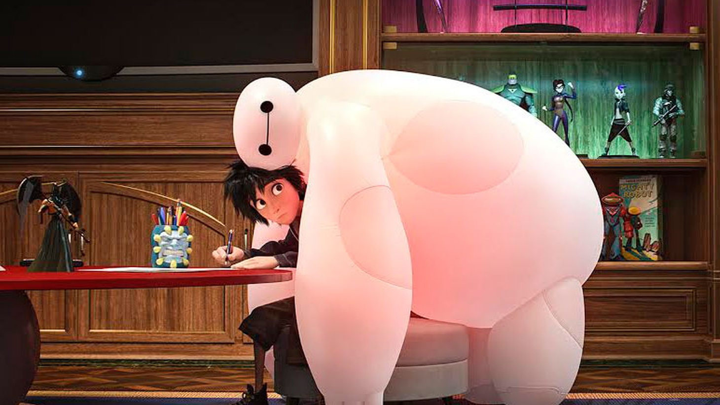 Big Hero 6 is the first Disney animated feature to use characters from the Marvel library, but it's not being marketed that way. Producer Roy Conli and Disney Animation Studios president Andrew Millstein explain why.
