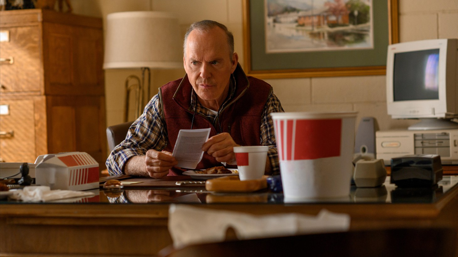 """In Hulu's """"Dopesick,"""" Michael Keaton plays a country doctor who is initially skeptical of Purdue Pharma's claim that its drug OxyContin is non-addictive."""
