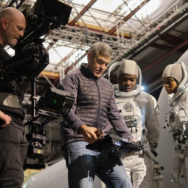 "In the new Netflix movie ""The Midnight Sky,"" George Clooney plays the lone scientist left on an Arctic observatory after an unnamed disaster makes Earth uninhabitable."