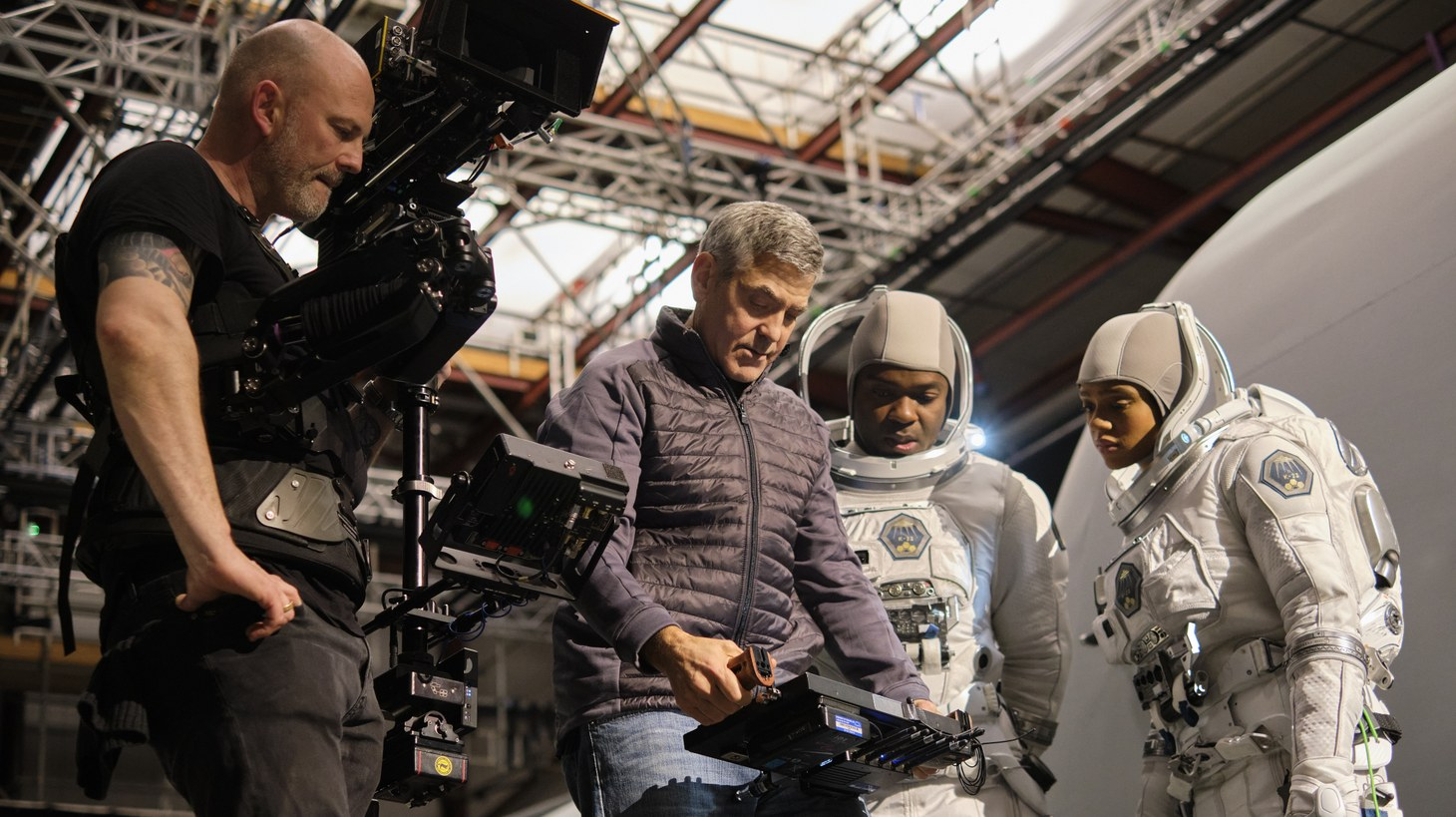 "George Clooney directs David Oyelowo and Tiffany Boone on the set of ""The Midnight Sky."""