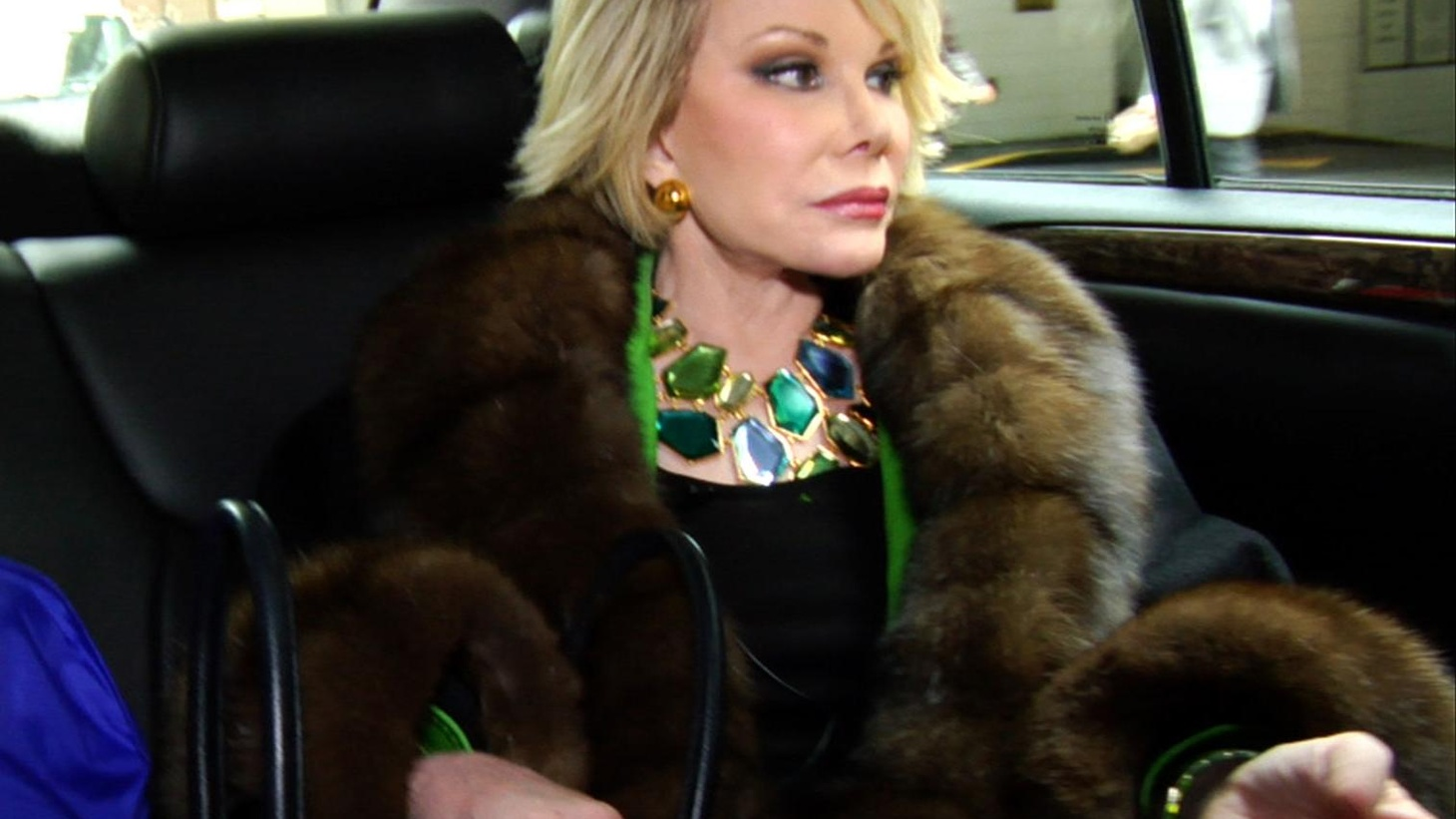 Joan Rivers may be best known for her off-color humor, working the red carpet, and her love of plastic surgery.  But in the new documentary, Joan Rivers: A Piece of Work, filmmakers Annie Sundberg and Ricki Stern reveal a woman who is an amazingly resilient industry pro, so committed to work that she won't let up even at the age of 77.