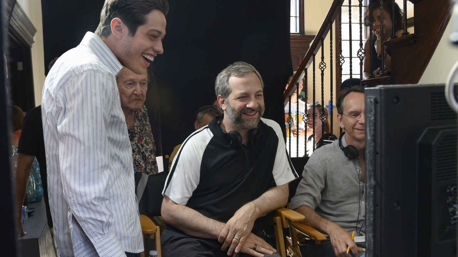 "Pete Davidson and director Judd Apatow with crew members on the set of ""The King of Staten Island."""
