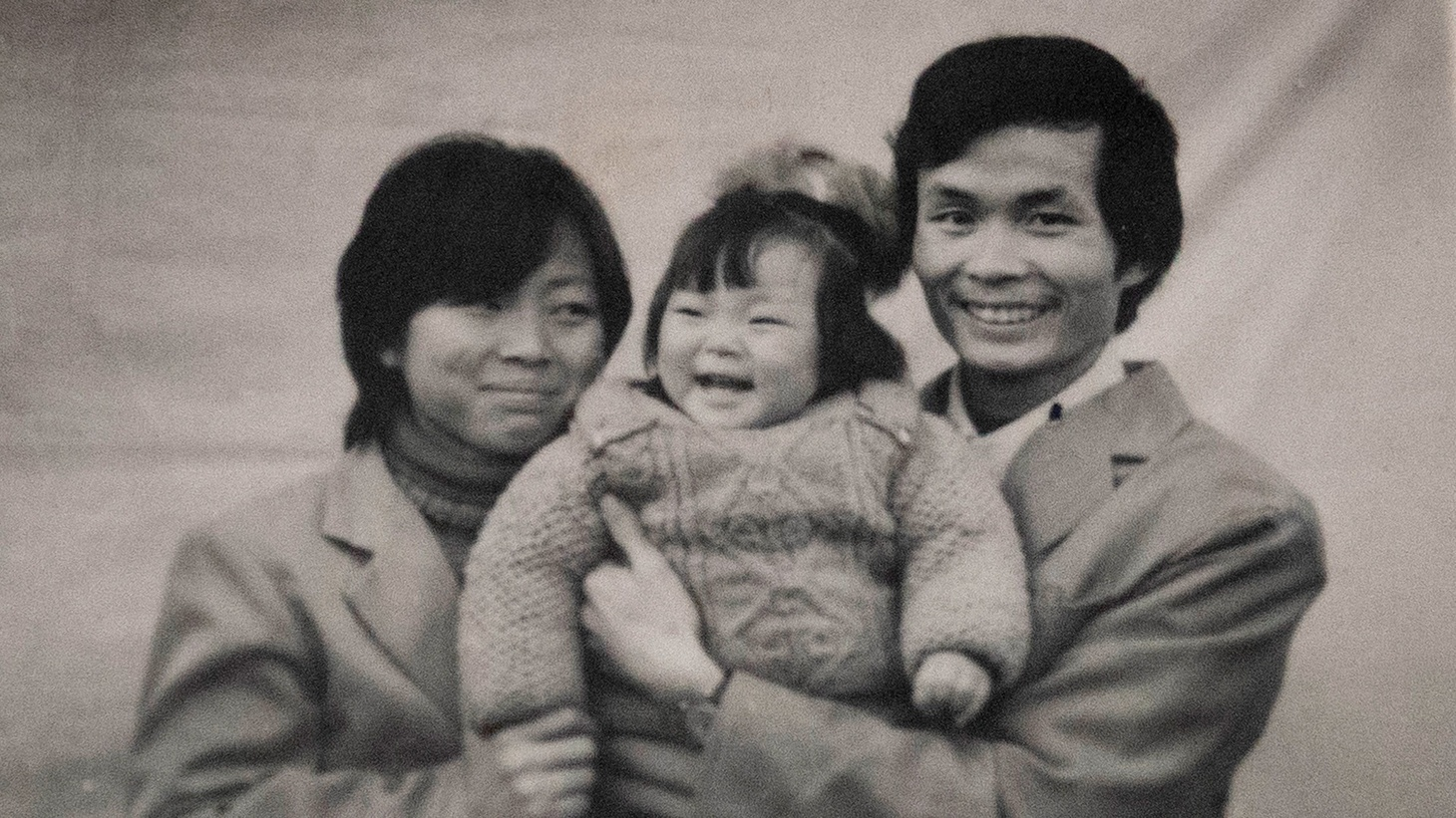 """Director Nanfu Wang as a small child, and her parents. Photo featured in """"One Child Nation"""""""