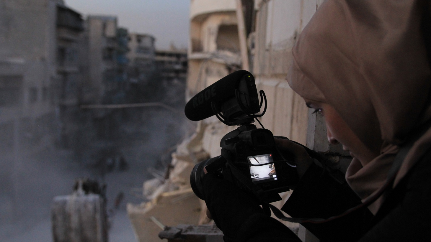 Waad al-Kateab filming the ruins of a building destroyed by bombing in besieged east Aleppo, October 2016.