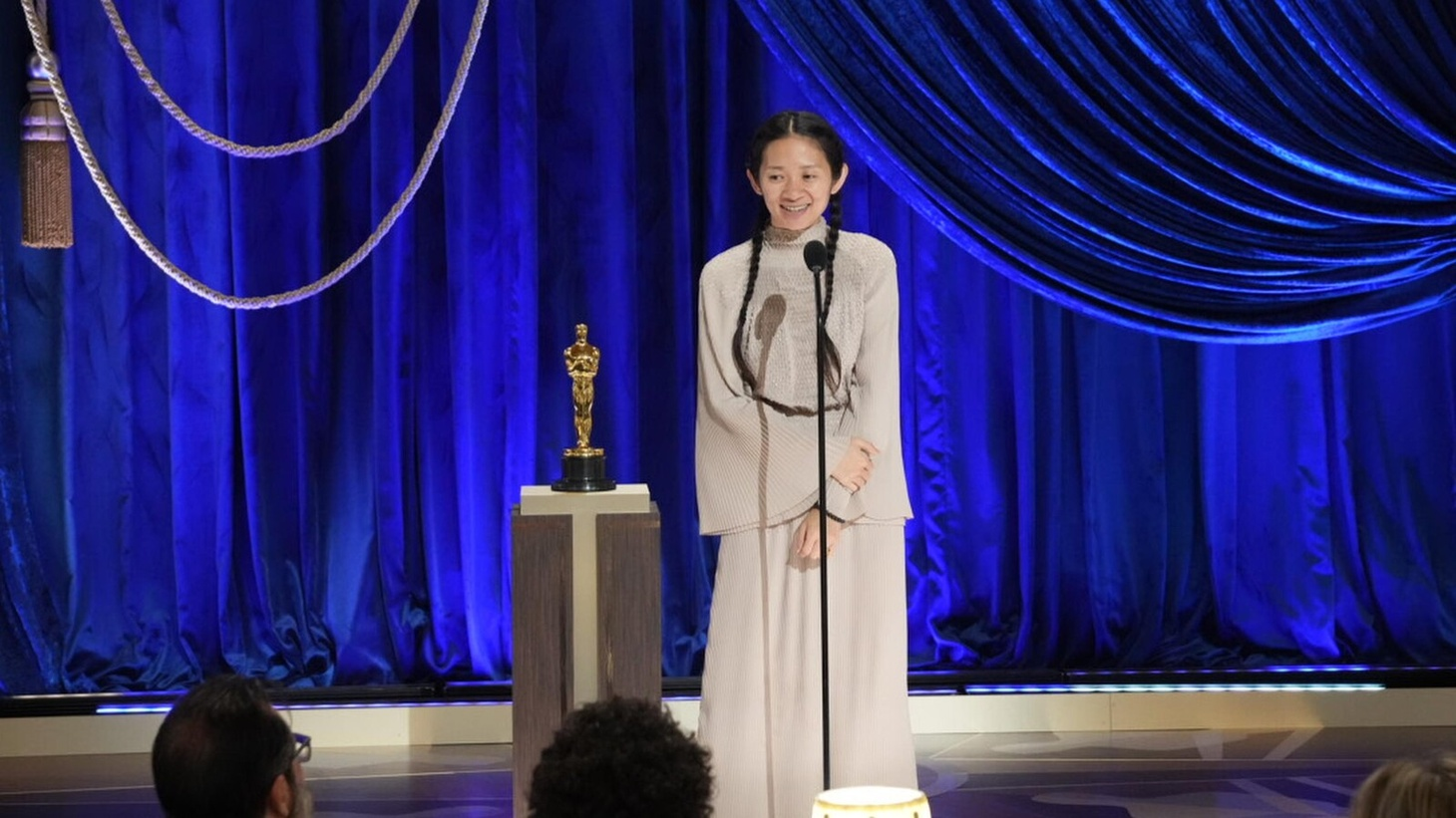 "Chloé Zhao accepts the Oscar for Best Director at the 93rd Academy Awards. Her film ""Nomadland"" also won Best Picture."