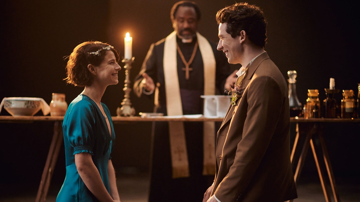 """Jessie Buckley (Juliet), Lucian Msamati (Friar Laurence) and Josh O'Connor (Romeo) in """"Romeo & Juliet"""" at the National Theatre. After the pandemic shut down the stage version of the famous play, Simon Godwin directed a film adaptation, now streaming on PBS."""