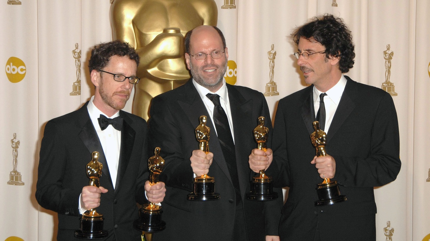 """Producer Scott Rudin (center) with Ethan Coen (left) and Joel Coen (right) with Oscars for """"No Country For Old Men"""" at the 2008 Academy Awards. Rudin has been accused of abusive workplace behavior for decades. Now former assistants are going on the record."""
