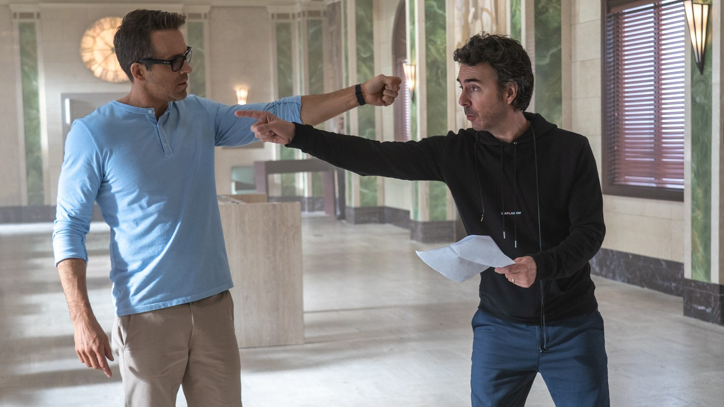 """Actor Ryan Reynolds and director Shawn Levy block a scene in """"Free Guy."""""""