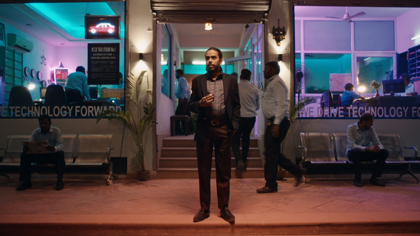 """Adarsh Gourav plays Balram, the clever servant-turned-businessman in the movie """"The White Tiger,"""" directed by Ramin Bahrani and based on the novel by Aravind Adiga."""