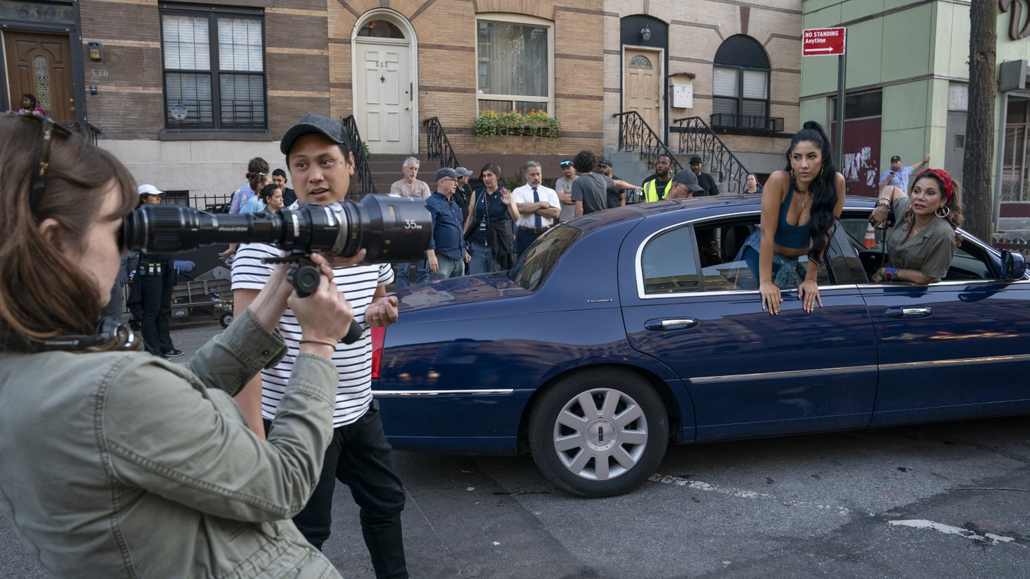"""(L-R) DP Alice Brooks, director Jon M. Chu, Stephanie Beatriz and Daphne Rubin-Vega on the set of Warner Bros. Pictures' """"In the Heights."""" The film is available June 11 on HBO Max, but Chu is pushing viewers to see it in theatres."""