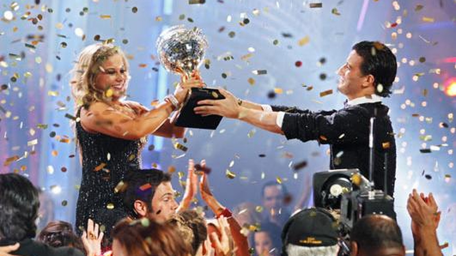 Shawn Johnson was a star of the Beijing Olympics last August. As of Tuesday night, with her upset win on Dancing with the Stars, Johnson's a much bigger star. It's a hard-hitting sign of our times that the trophy of a reality television show, a mirrored disco ball, carries more weight than an Olympic gold medal but even the hype and summer dominance of the Olympics can't compete with the sustained huge audiences that tune in by the many millions every week for almost three months to Dancing with the Stars...