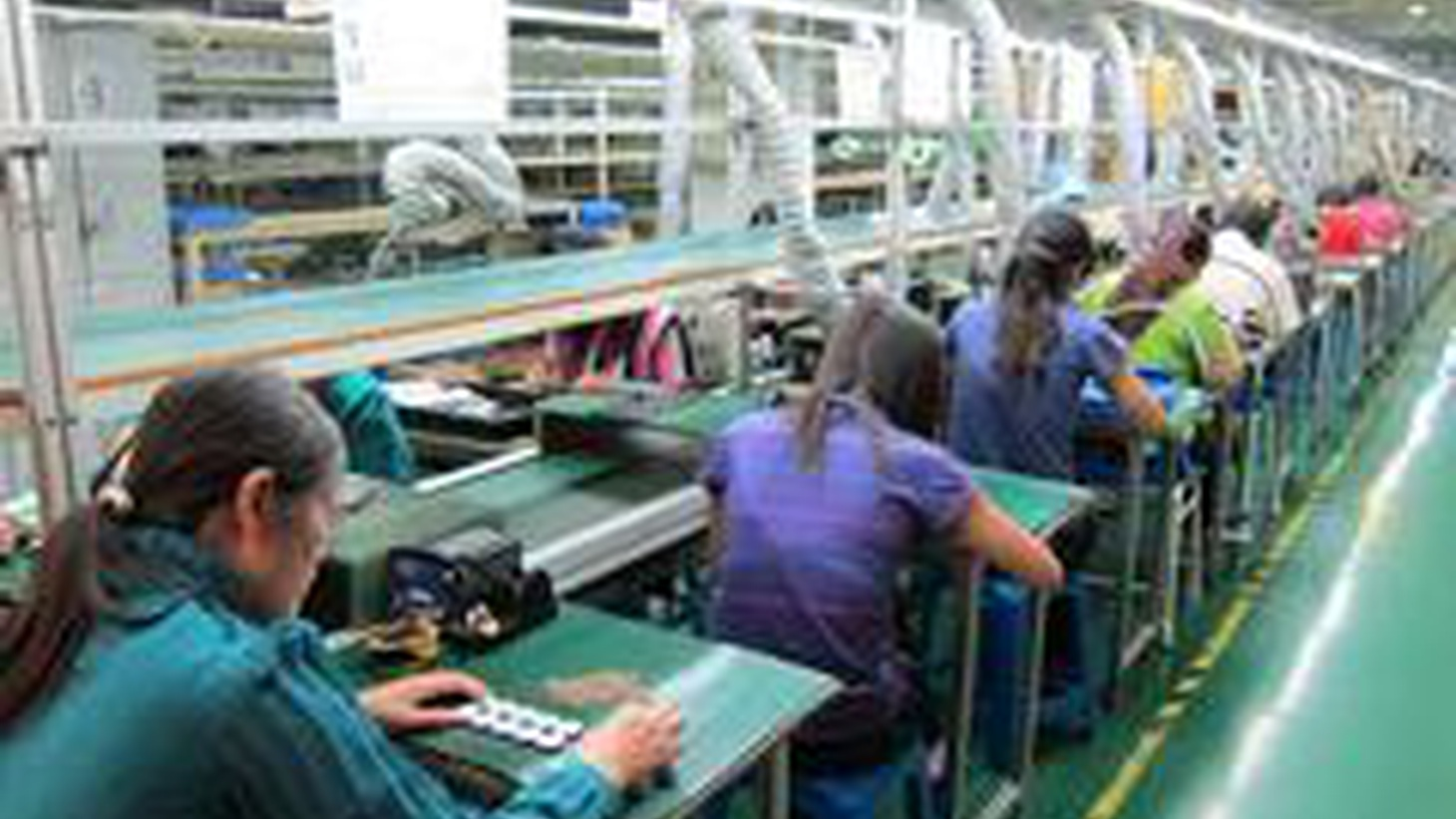 """After seeing images on a brand new iPhone taken by workers where it was made, a """"worshipper in the cult of Mac"""" goes to China to discover who actually makes it all..."""