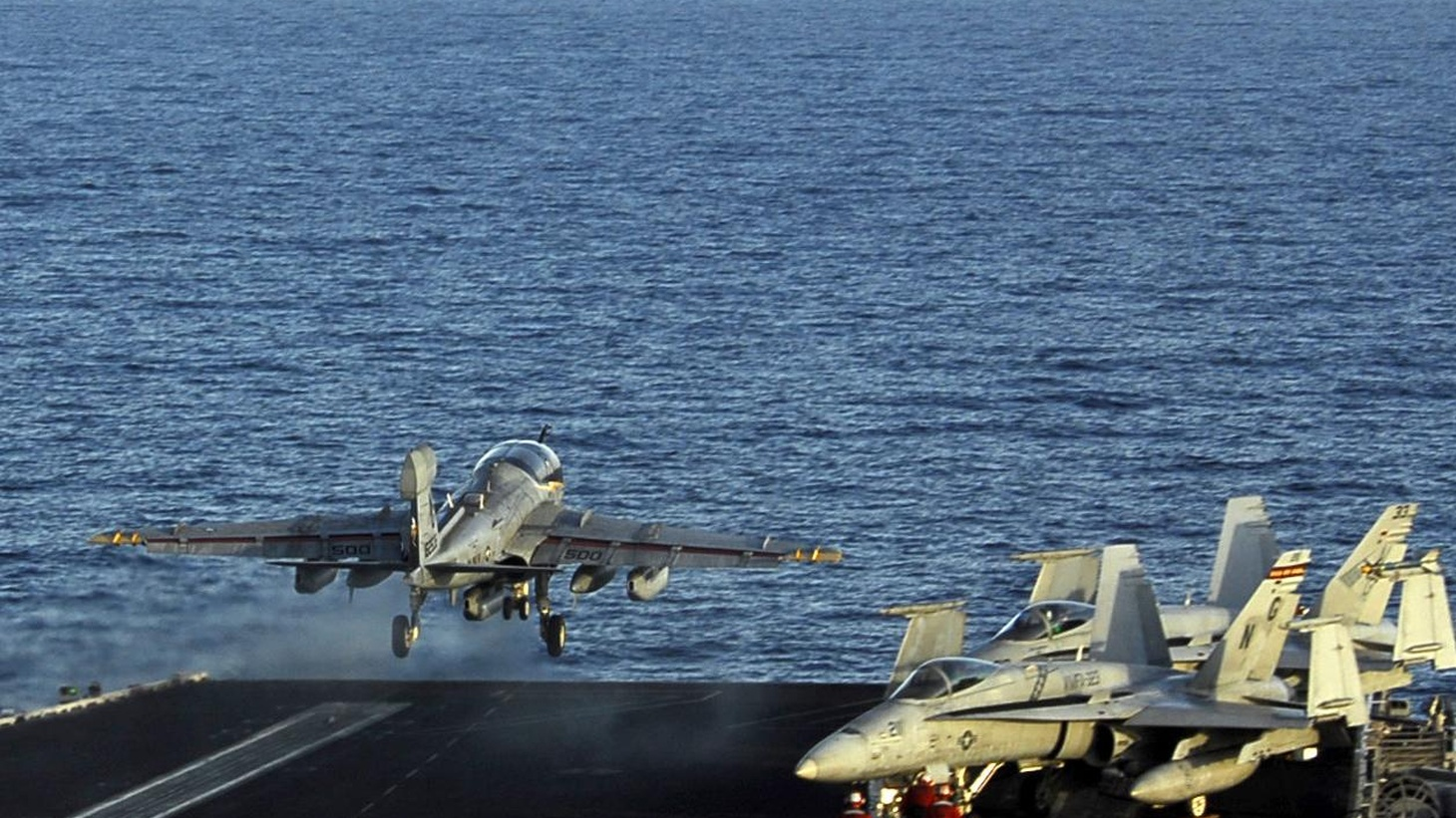Only a few dozen people aboard the USS John C. Stennis actually fly F-18s and F-14's. It takes the rest of the crew - over 5,000 people - to keep them in the air.