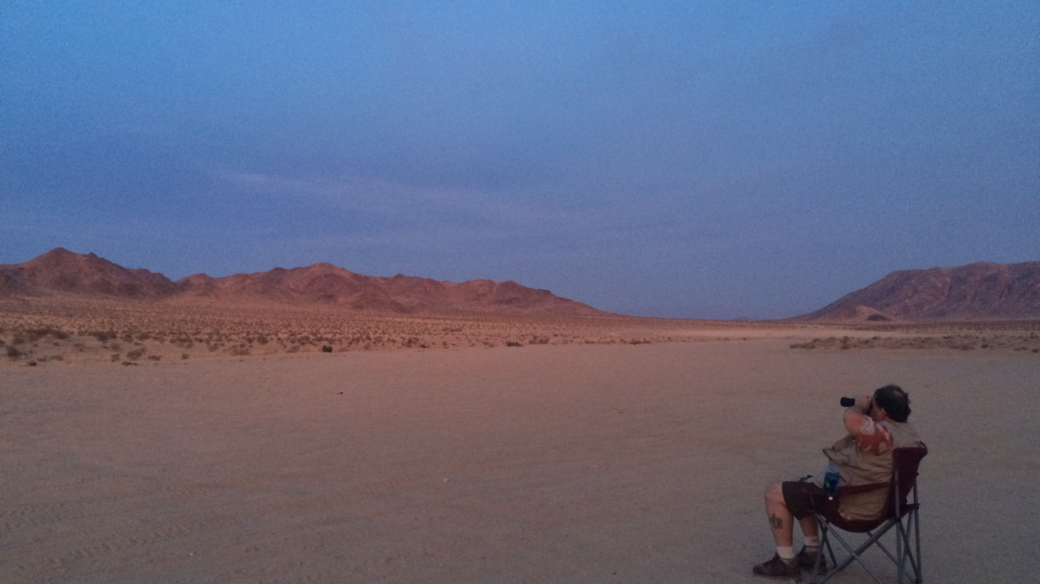 There's a place in the desert where people gather. They have different beliefs. But when they look into the night sky, they all share one idea.