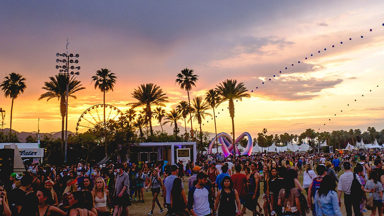 Sunset during Coachella 2014, with the balloon chain and Lightweaver art installation visible.