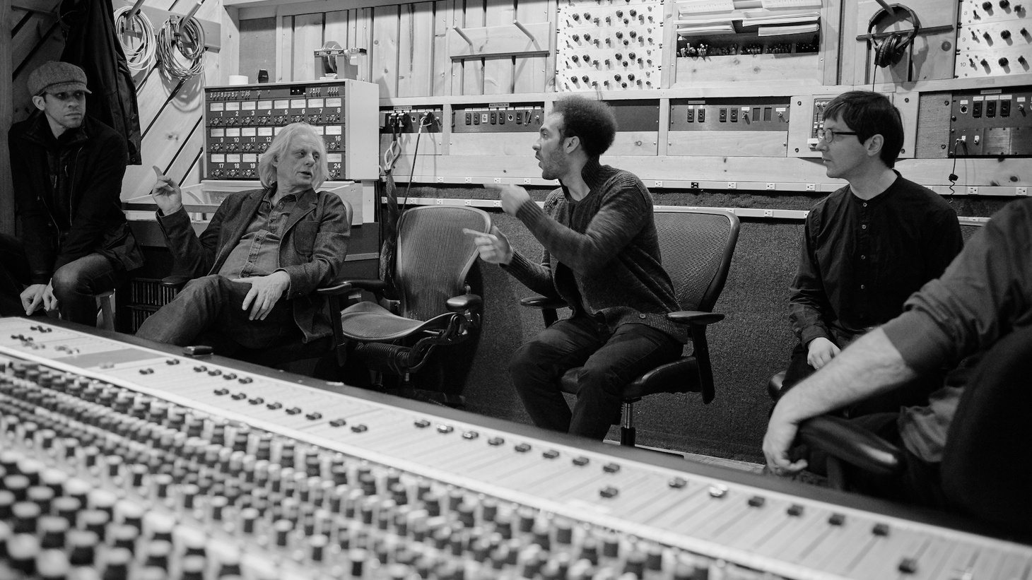 "ECM founder Manfred Eicher (second from left) in the studio with Cuban-born pianist David Virelles (center), Adam Cruz, and Thomas Morgan – during the group's session for the 2017 album ""Gnosis."""