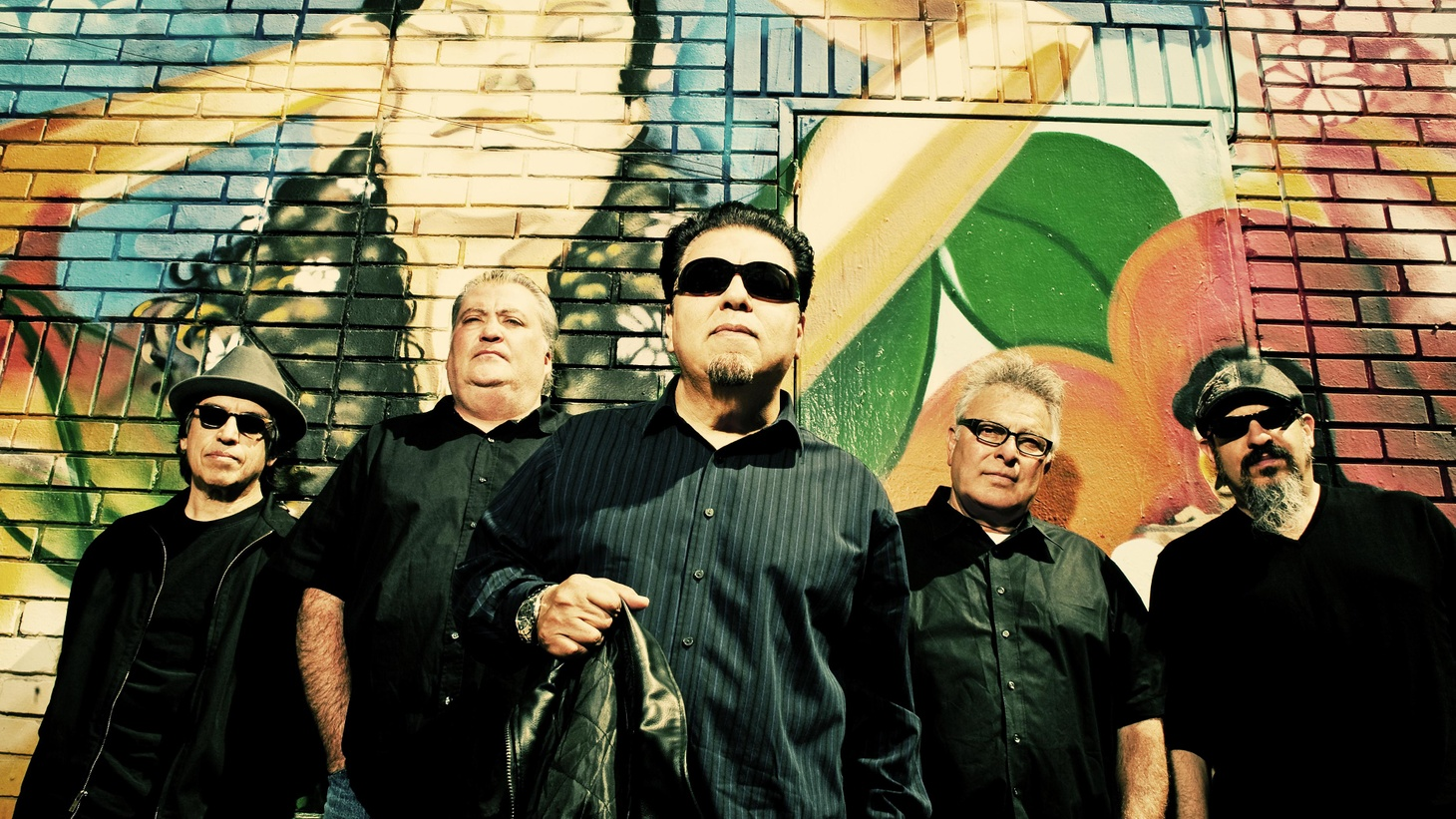 Los Lobos are more than just a band, they're an institution.  And not just a Los Angeles institution, as their 1978 album, Just Another Band from East L.A., satirically alerts us.  They are an international, Grammy-Award-winning, alternative rock (in the truest sense of the phrase) institution, whose newest release, Tin Can Trust, only proves the point.