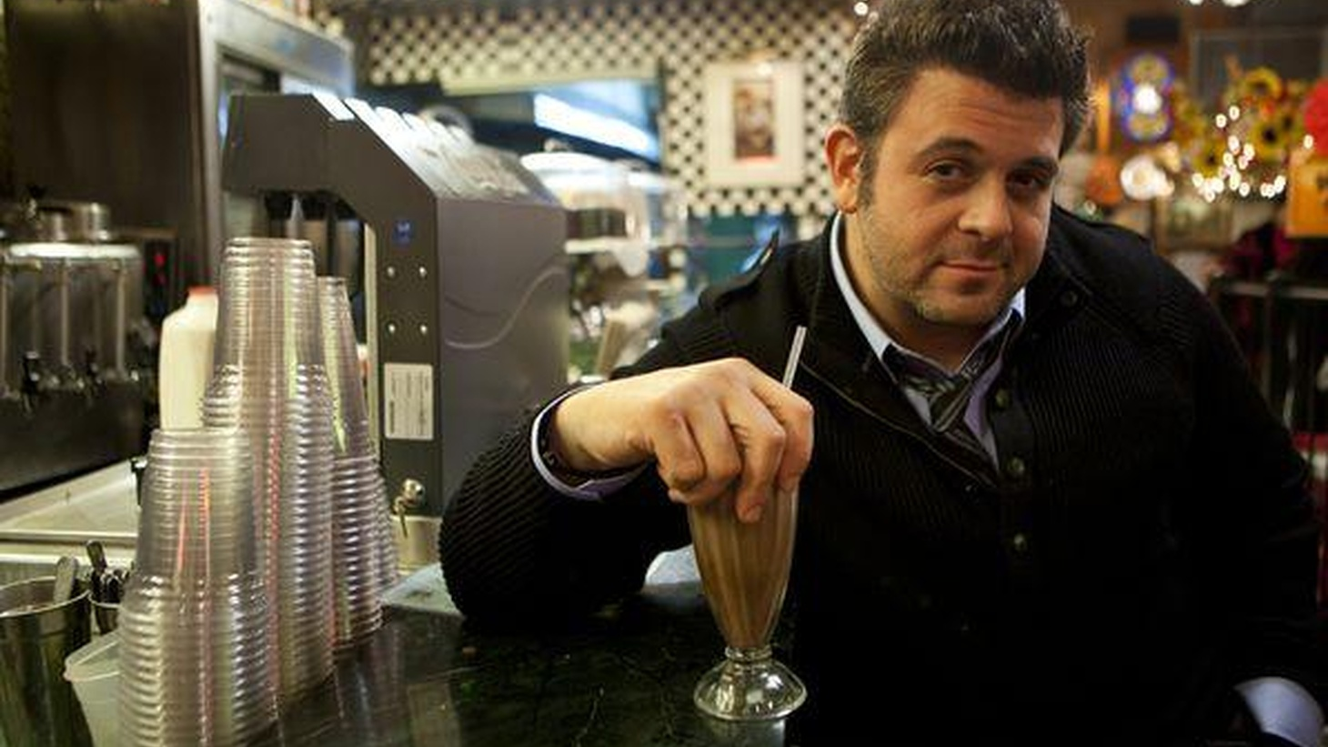Adam Richman has accomplished some incredible culinary feats across the country on his show Man vs. Food, but it's his Brooklyn roots that inspire his musical choices, including the Beastie Boys and Jay Z.