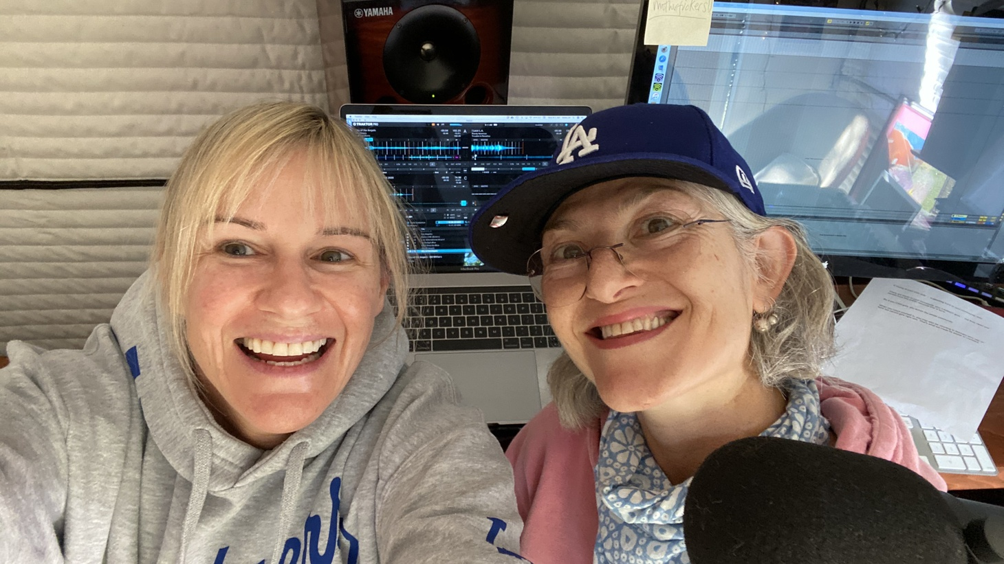 Anne Litt and Ariana Morgenstern celebrate the Dodgers championship win in the Morning Becomes Eclectic studio in Litt's house.