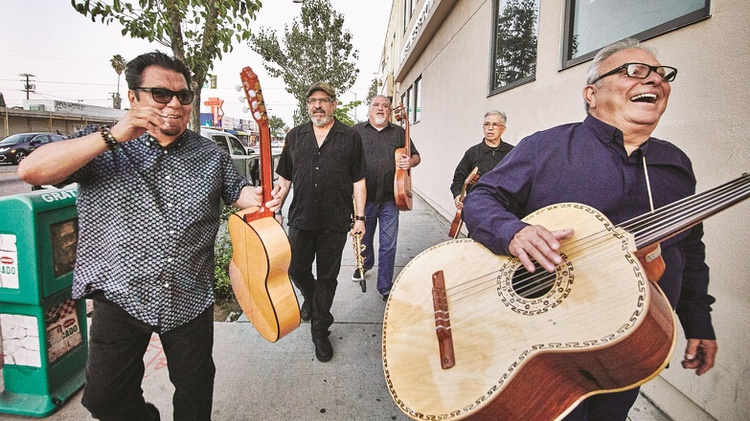 East LA icons Los Lobos released their first ever Christmas album Llego Navidad earlier this fall.