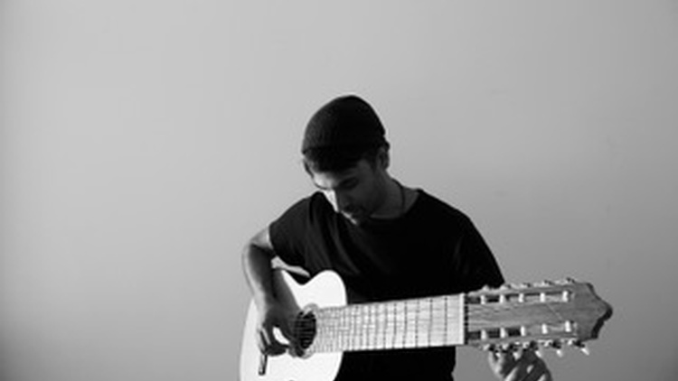 Back in 2015, Tom Schnabel shared music by an extraordinary acoustic guitarist he'd heard that played a seven-string guitar.