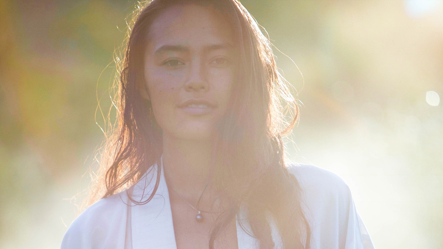 """Singer/songwriter Ash grew up in the lush landscape of Oahu and is now an organic farmer in British Colombia. Focused on sustainability and growth, Ash plants seeds of love through her song """"Lover Friend."""""""