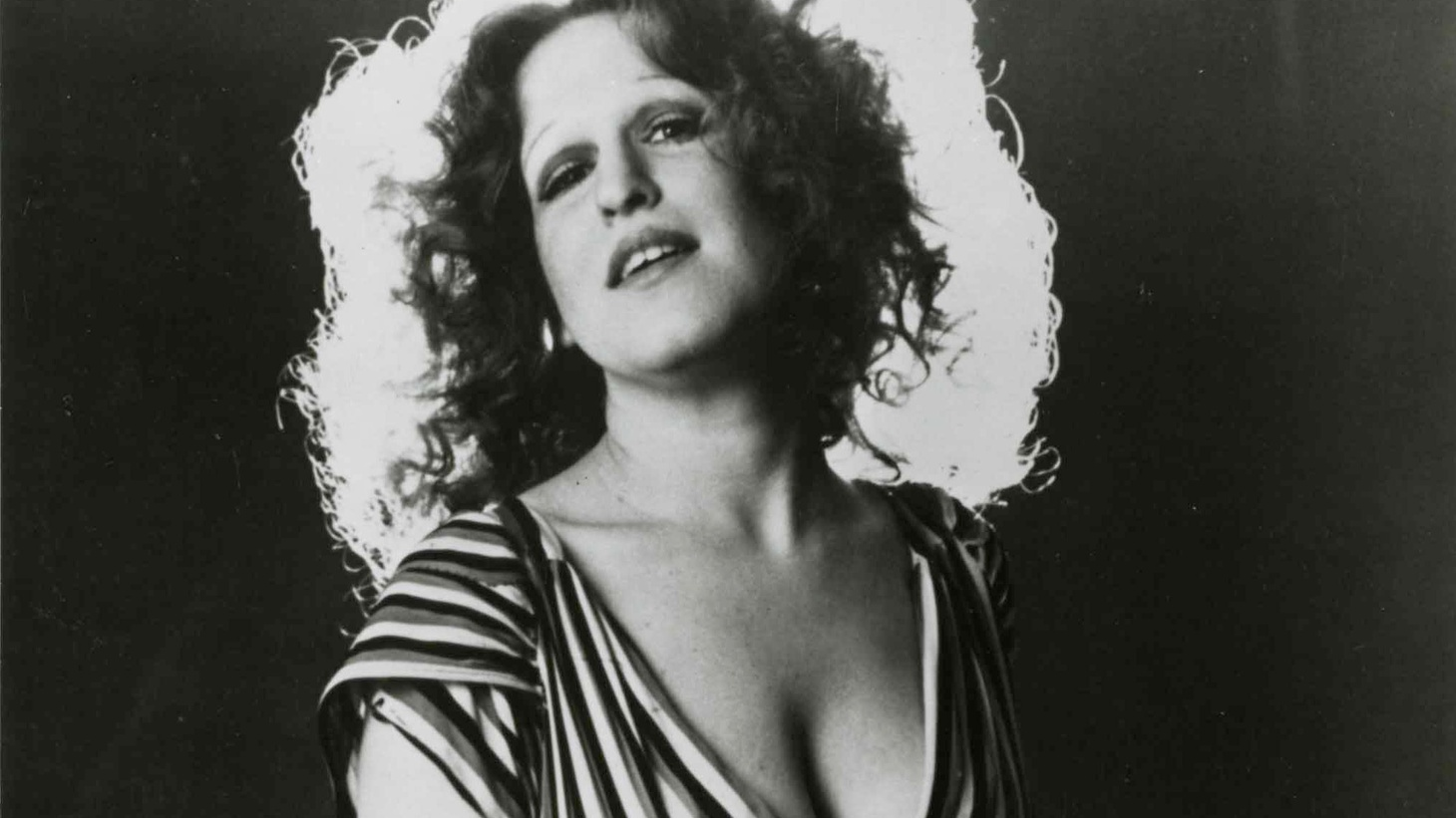 The Divine Miss M is back! The iconic 1972 debut album that launched Bette Midler's career will be re-released in October alongside a bonus disc of singles, outtakes and demos.