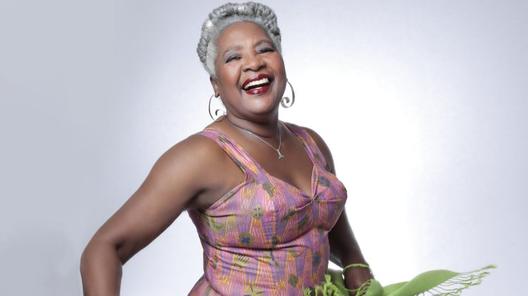 """Majestic Cuban singer and bandleader Bobi Céspedes celebrates a 40-year career and lets her voice soar on """"Mujer y Cantante"""" (""""woman and singer""""), plainly telling her tale via deep…"""