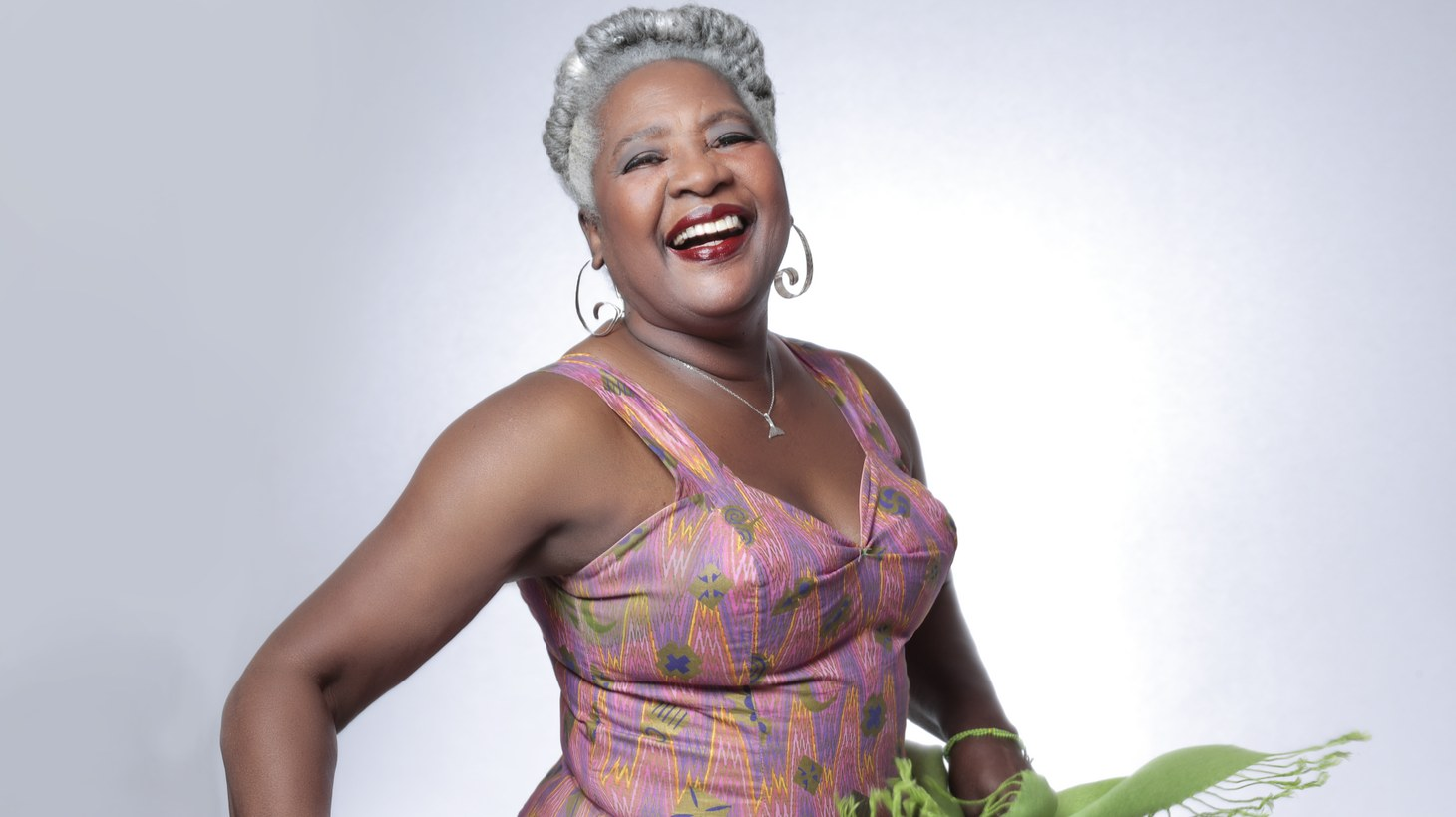 """Majestic Cuban singer and bandleader Bobi Céspedes celebrates a 40-year career and lets her voice soar on """"Mujer y Cantante"""" (""""woman and singer""""), plainly telling her tale via deep Afro-Cuban rhythm and flare."""