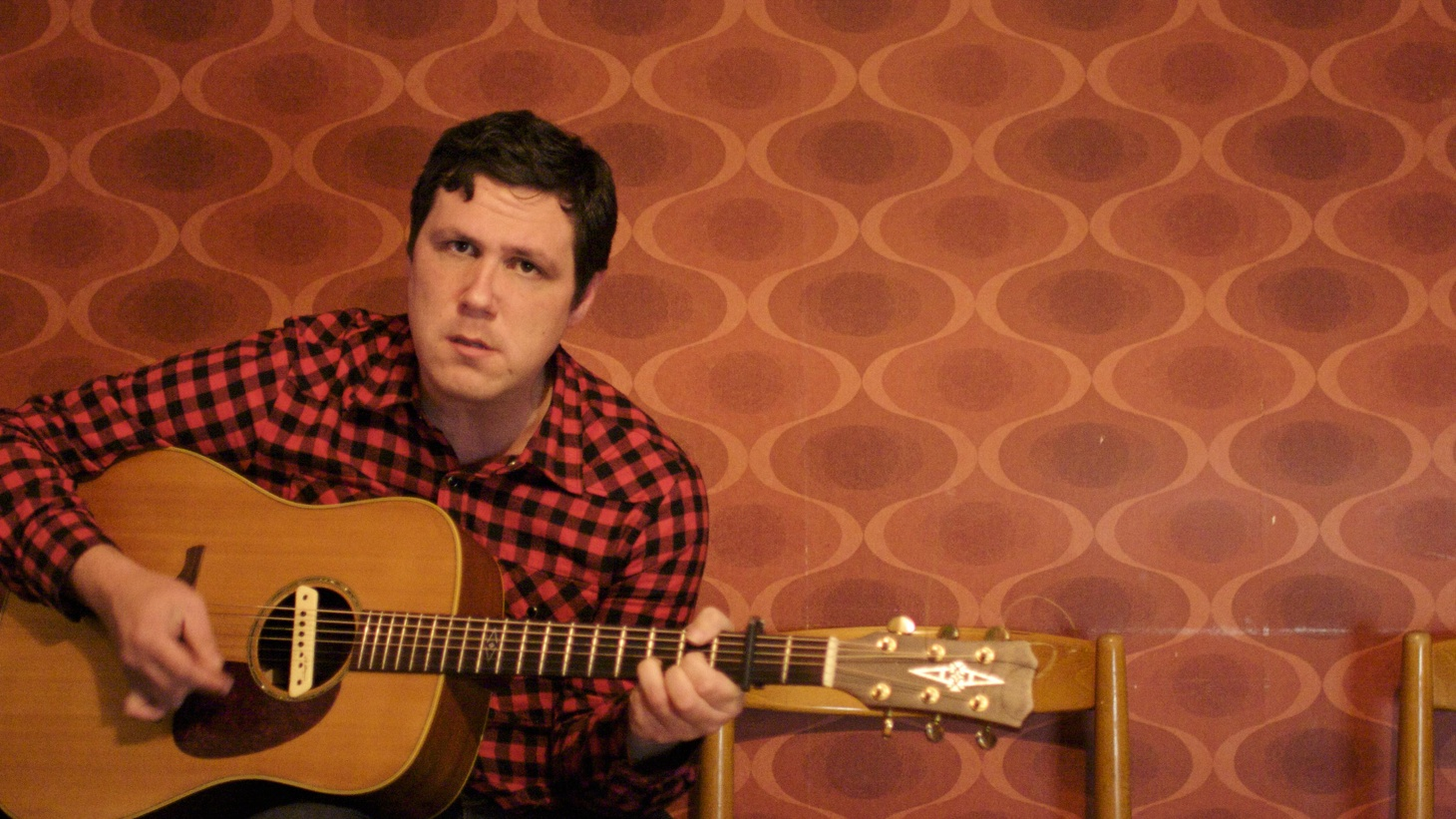 "Damien Jurado is a school teacher by day that follows his musical muse at night. Prolific and dedicated, his songs spin tales that have earned him comparisons to short story writer Raymond Carver. His latest release, Saint Bartlett, is produced by like-minded artist Richard Swift who helps transform Jurado from musician to mystic. Today's Top Tune is ""Cloudy Shoes."""