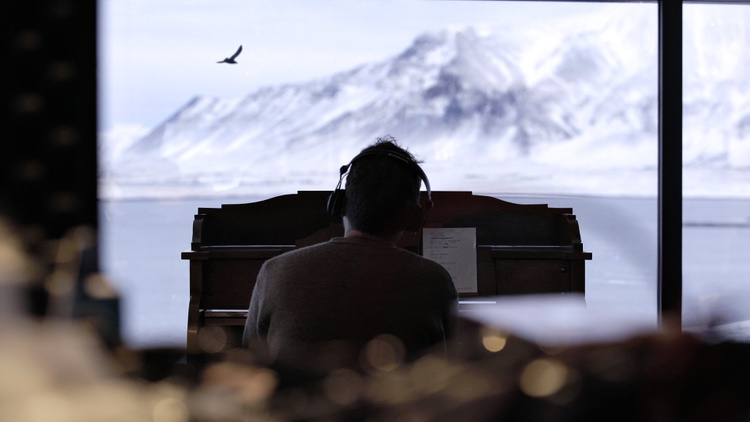 """Shapeshifting musical guru Damon Albarn positioned his piano to overlook the sea in Iceland to write and record his brand new solo album, """"The Nearer The Fountain, More Pure The Stream…"""