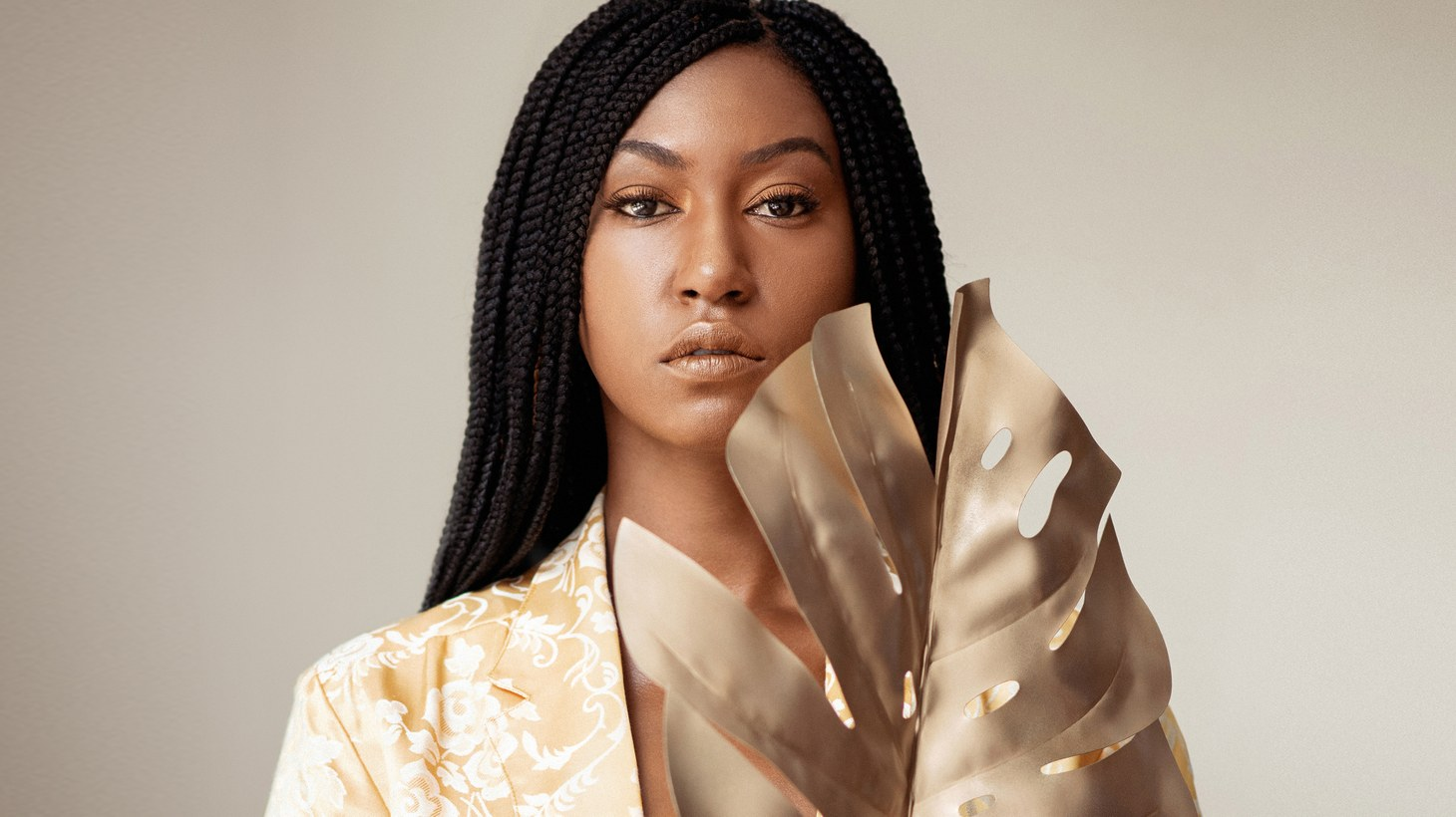 """Canadian artist Dominique Fils-Aime must have a time-traveling machine because """"While We Wait"""" sounds like it was lifted from a 50's girl group and dropped into today's current issues with a little gospel and soul sprinkled in."""
