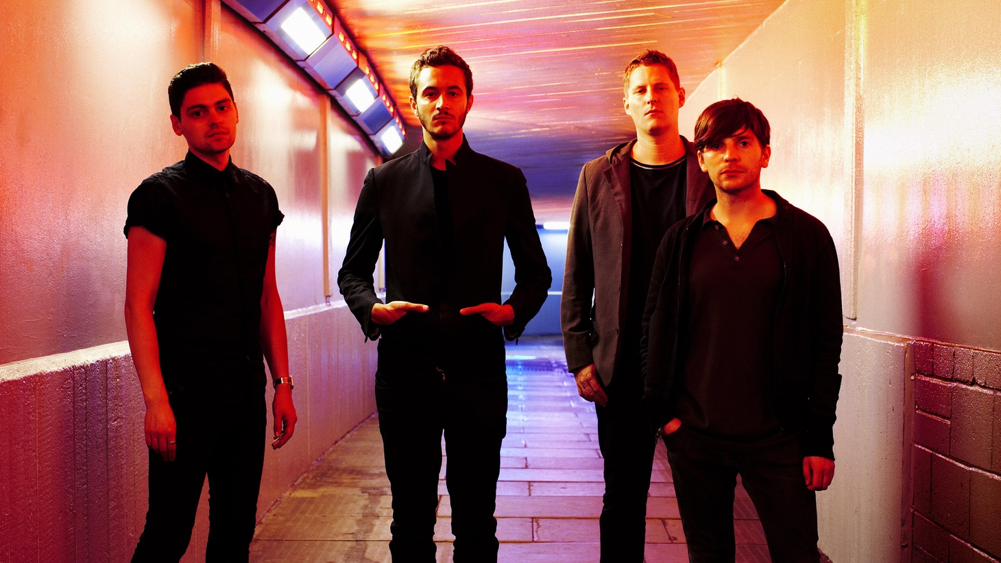 """In 2003, Editors signature sound was part of the post-punk revival happening in the U.K. By 2009, these Brummies took on a new direction tinkering with synthesizers and enlisting producer Flood (of Nine Inch Nail and Depeche Mode fame) to help expand their sound. Today's Top Tune is from the album In This Light and on This Evening, and is called """"The Boxer."""""""