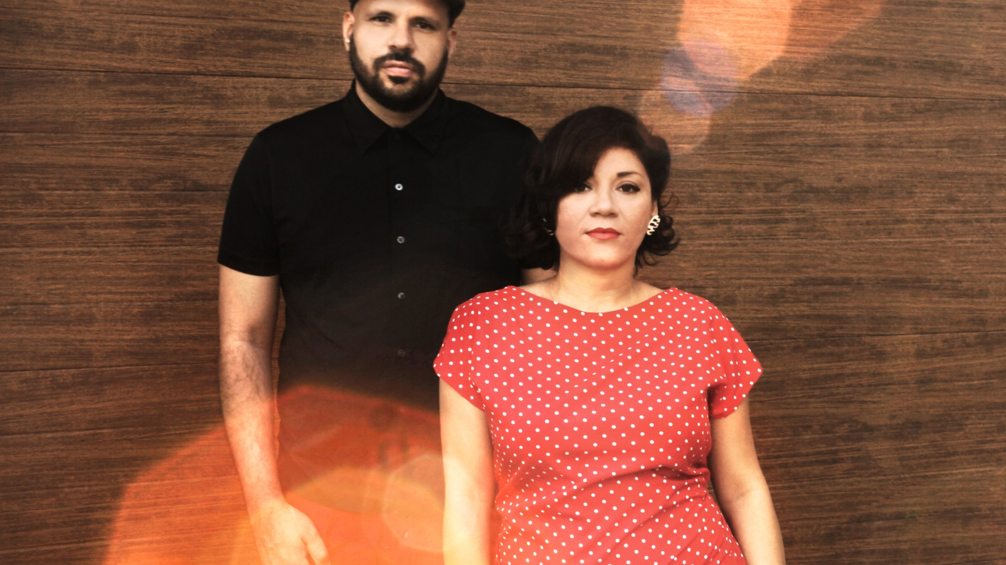 Andres Ponce and Sofy Encanto are united by marriage and musically as Elastic Bond, but that's not all that they have merged together. The Miami couple has fused cultures that reflect their surroundings -- folkloric rhythms and electronic beats -- on their funky new album Honey Bun.