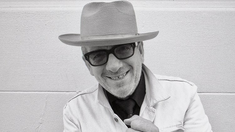 """Back in February, Elvis Costello travelled to Helsinki — a place where he thought he could work incognito — to record """"No Flag."""" He plays everything you hear: drums, Fender…"""