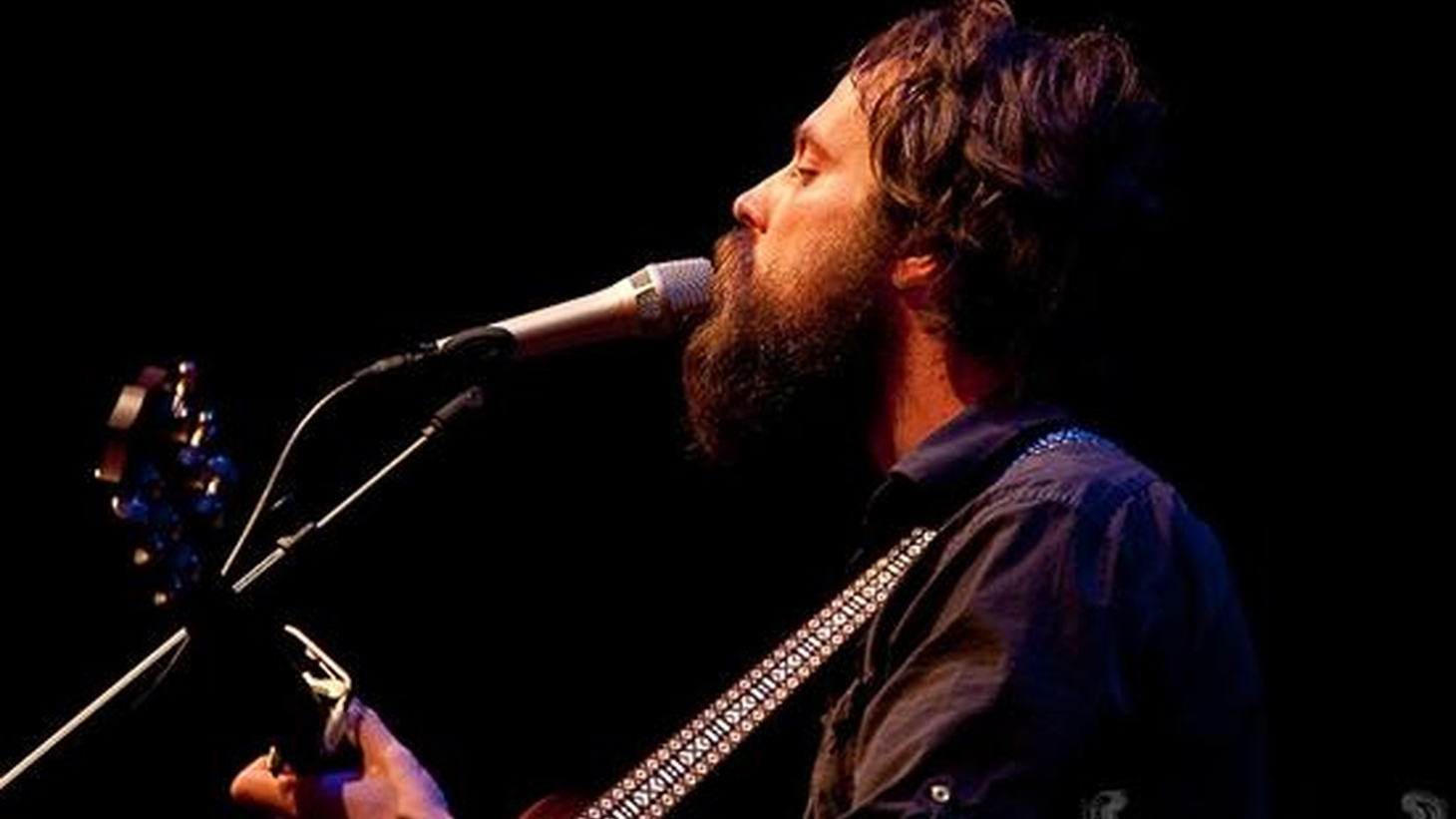 """Sam Beam, best known as Iron & Wine, really beefs up his sound on his new release, Kiss Each Other Clean. Backed by a large band and unexpected instrumentation, his tender melodies are complimented by sumptuous vocals. Today's Top Tune features his sister, Sarah Simpson, as back up vocalist on """"Half Moon."""""""