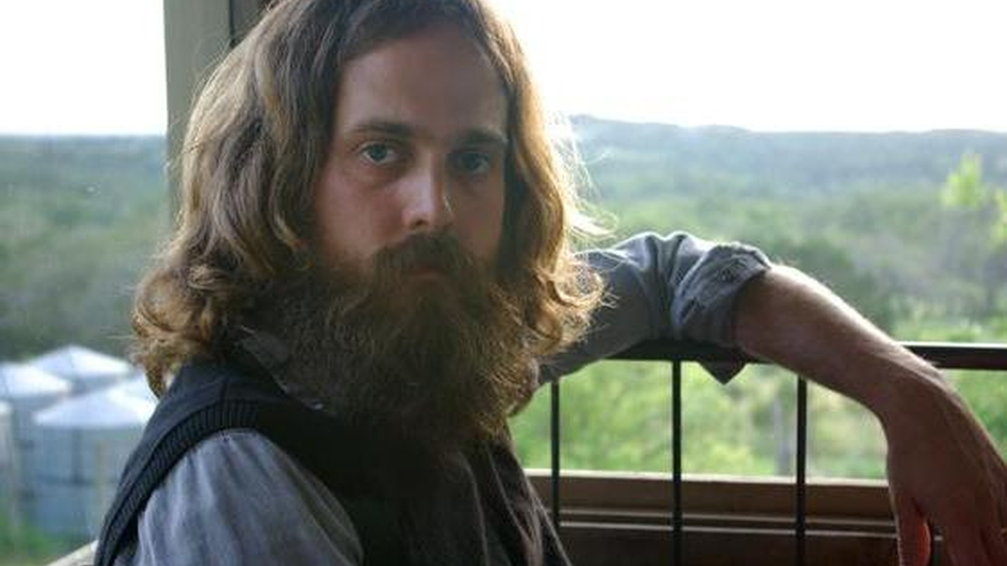 from Around the Well.   Sam Beam is the man behind the moniker Iron & Wine. His latest release is a double-CD compilation...