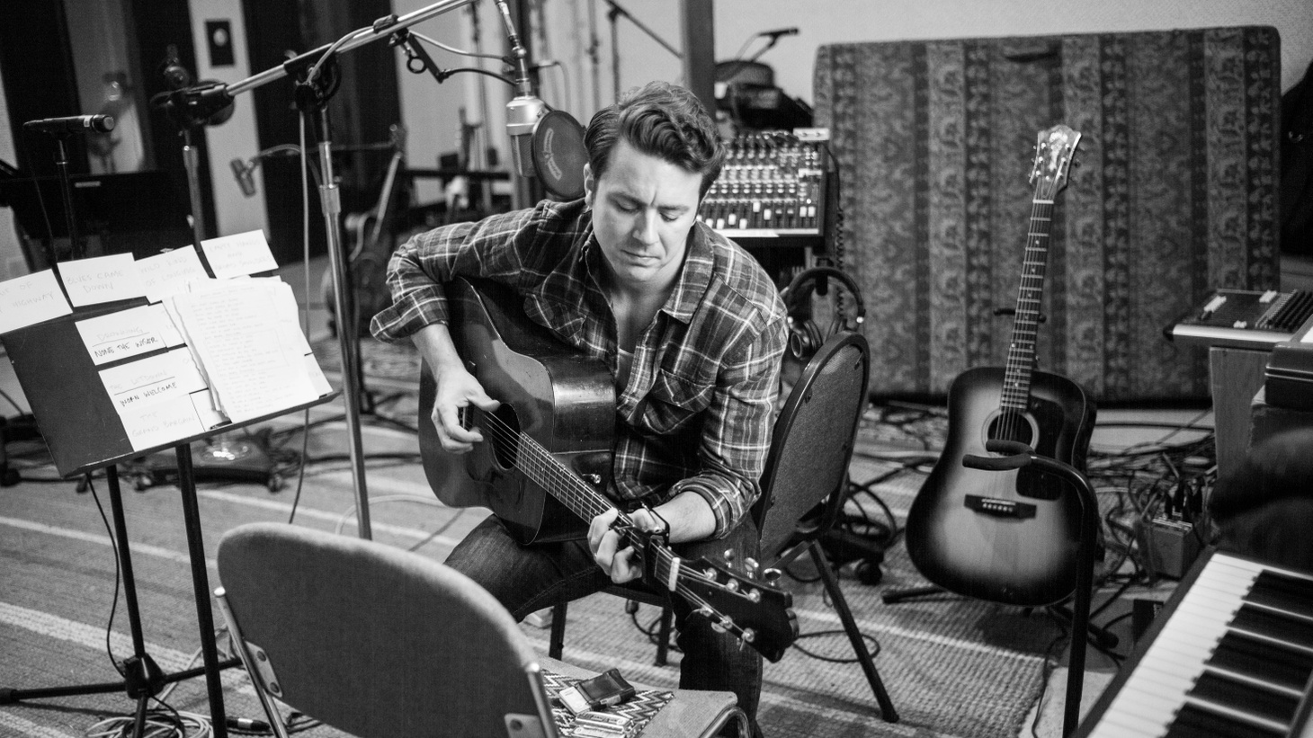 """Joe Pug focuses in on the simplicity of friends gathered in a circle making music with """"The Flood In Color."""" The track produced by Kenneth Pattengale of Milk Carton Kids has a timeless feel."""