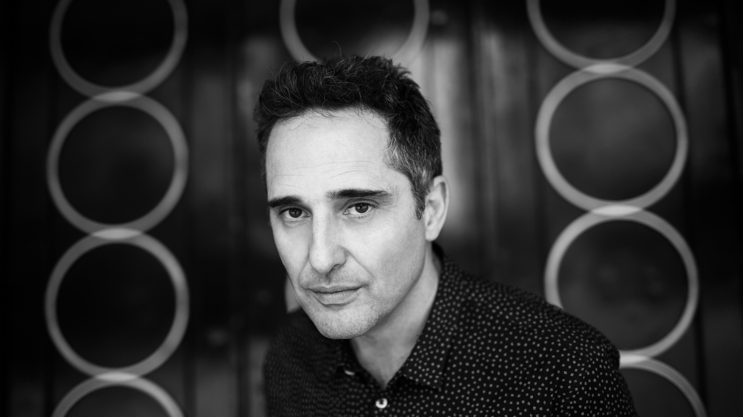 "Grammy and Oscar winning artist Jorge Drexler reflects on love and technology on ""Telefonía,"" as he praises this modern device as a way to shorten the distance between two hearts."