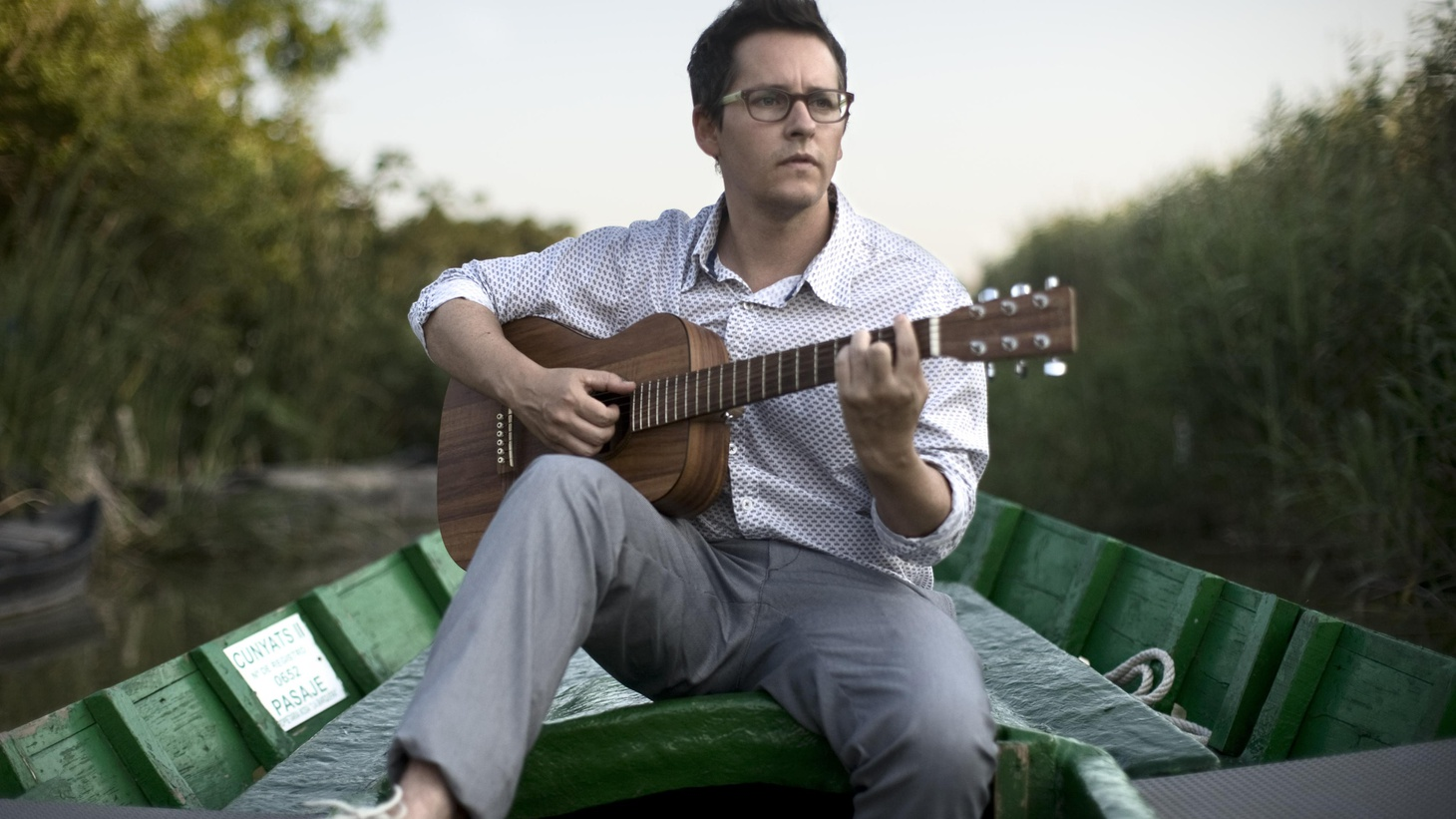 "Josh Rouse is an American artist living in Spain. His new release, El Turista reflects his life in Valencia and is a globe-trotting musical journey with influences from Brazil, Cuba and Africa.  Today's Top Tune was written with his wife, Paz Suay and has him singing in Spanish, it's ""Las Voces."""