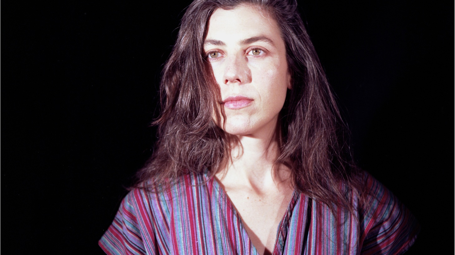 """Somewhere between whirling strings and dazzling arrangements, we hear Julia Holter's haunting vocals emerge on """"Words I Heard."""" It's a soft place to land when the world gets too chaotic."""