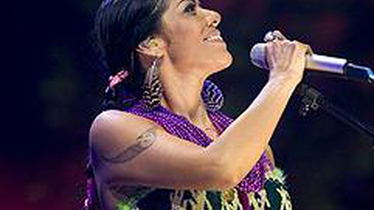 ...from Shake Away.   Lila Downs grew up in Oaxaca and Minneapolis which explains a lot. She can sing jazzy songs in English while lending them a little Latin spice.