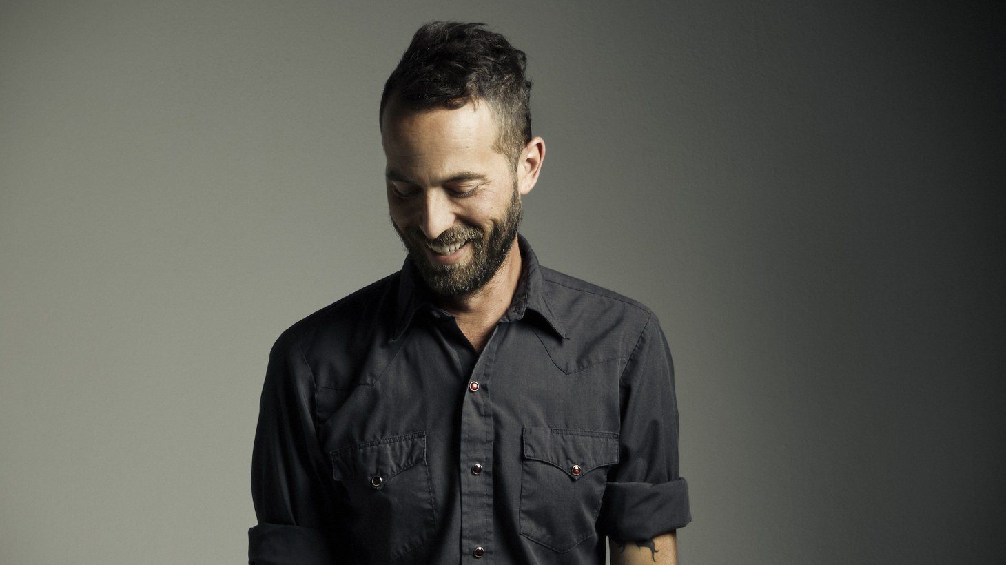 "Mondo Cozmo aka Josh Ostrander literally put blood, sweat and tears into his second full-length recording. Putting his fist through a wall eventually lead to some of his best work yet on ""Come On."""
