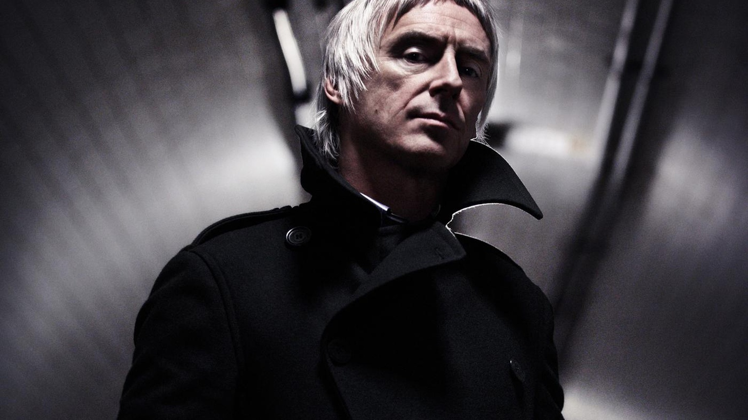 """Paul Weller's always shown a wide ranging sound - from The Jam to his time with the Style Council. His latest release, Wake Up The Nation, sets a new course for the singer, a grittier urban direction that reflects city life and a call to raise up from mediocrity. Today's Top Tune is """"Find The Torch, Burn The Plans."""""""